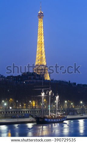 Paris, France-March 12, 2016 : The Eiffel tower is historical and architectural monument located on the bank of Seine river in Paris, France. - stock photo