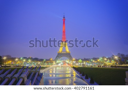 Paris; France-March 24, 2016 : The Eiffel tower lit up with the colors of National Belgian flag to victims of terrorist's attack in Brussels.pray for Belgium : Belgium's flag shines over Eiffel Tower