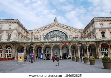 PARIS, FRANCE - MARCH 18, 2014: The exterior of the Gare De L'Est (East Station), one of the main railway stations in Paris. Designed by architect Francois Duquesnay, the station first opened in 1849. - stock photo