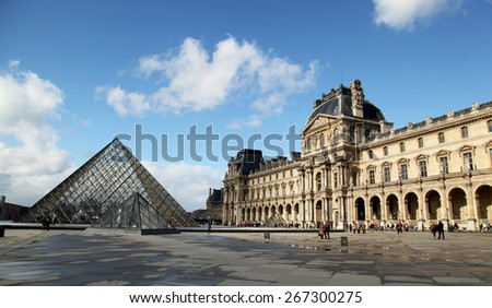PARIS, FRANCE - MARCH 02, 2014:  The Louvres Museum is one of the world's largest museums and a historic monument in Paris, France.  - stock photo