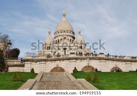 PARIS, FRANCE - MARCH 19, 2014: The Roman Catholic Basilica of Sacre Coeur at Montmartre. Designed by Paul Abadie, construction began in 1875 and was completed in 1914.  - stock photo