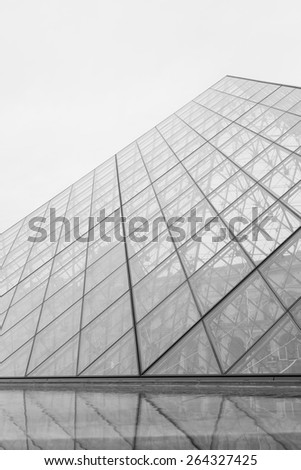 PARIS, FRANCE - MARCH 13, 2015: View of pyramid and fountain at courtyard of Louvre Museum. Louvre Museum is one of the largest and most visited museums worldwide.
