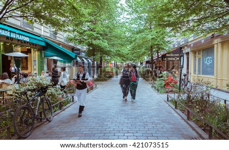 Paris, France - May 8, 2016. A quiet street with restaurants in the bohemian Marais district of Paris - stock photo