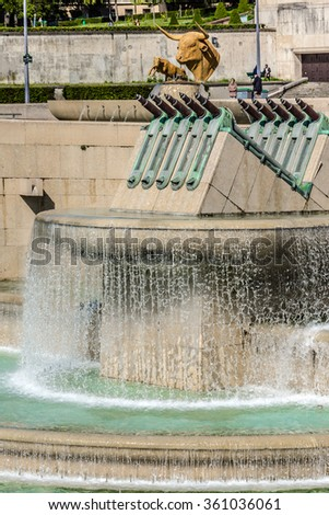 PARIS, FRANCE - MAY 16, 2014: Animals in fountain of Trocadero gardens. Trocadero is area of Paris on banks of Seine not far from famous Eiffel Tower.