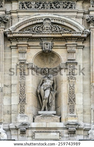 PARIS, FRANCE - MAY 8, 2014: Architectural fragments of Louvre building. Louvre Museum is one of the largest and most visited museums worldwide. - stock photo