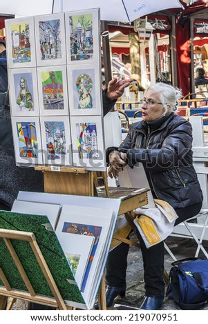 PARIS, FRANCE - MAY 15, 2014: Artists easels and artwork set up in Place du Tertre in Montmartre. Montmartre attracted many famous modern painters in the early 20th century.
