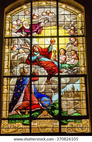 PARIS, FRANCE -  MAY 31, 2015 Basilica  King Christ Sacret Heart Stained Glass Church Saint Louis En L'ile Church Paris France.  Saint Louis En L'ile church built in 1726