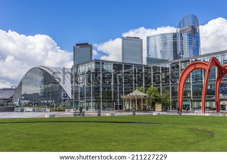 PARIS, FRANCE - MAY 13, 2014: Carousel near skyscrapers in business district of Defense to west of Paris. Defense is biggest business district in France and most of large companies have offices here.