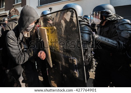 Paris, FRANCE - MAY 17, 2016 : Demonstrator inf front of french police, anti-riot squad, during the massive protest over the labor law reforms.