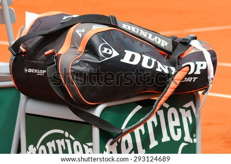 PARIS, FRANCE- MAY 28, 2015: Dunlop Performance tennis bag at Le Stade Roland Garros in Paris. Dunlop Sport is a British sporting goods company that specializes in tennis and golf equipment - stock photo