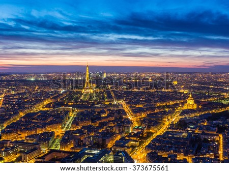 PARIS, FRANCE - MAY 1 : Eiffel Tower brightly illuminated at dusk on May 1 2013 in Paris. The Eiffel tower is the most visited monument of France. - stock photo