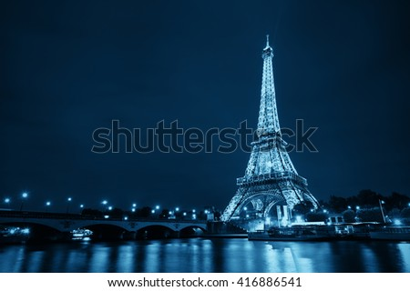 PARIS, FRANCE - MAY 13: Eiffel Tower night view on May 13, 2015 in Paris. It is the most-visited paid monument in the world with annual 250M visitors. - stock photo