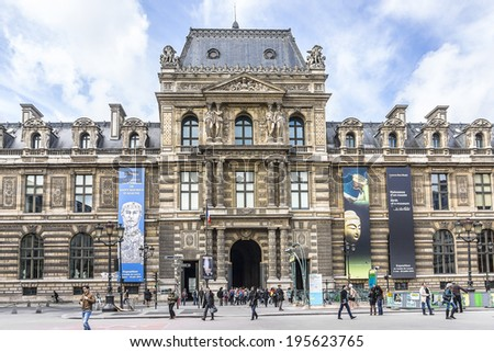 PARIS, FRANCE - MAY 8, 2014: Entrance to the Louvre Museum. With 8.8 million annual visitors, Louvre is consistently the most visited museum worldwide. - stock photo
