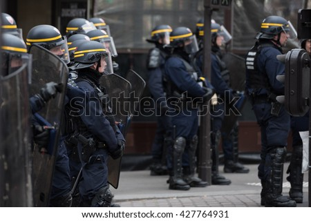 Paris, FRANCE - MAY 26, 2016 : French police, anti-riot squad, monitoring crowd to contain people during the massive protest over the labor law reforms.
