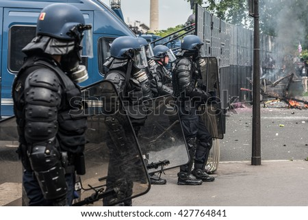 Paris, FRANCE - MAY 26, 2016 : French police, anti-riot squad, try to control people during the massive protest over the labor law reforms.