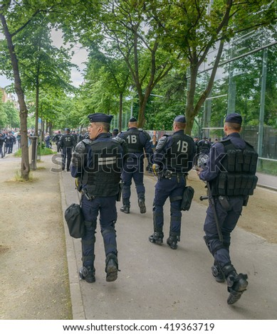 Paris, France - May 12, 2016 - French unions and students protest in Paris, France after the government forced through controversial labour reforms. Police line up to keep the peace. - stock photo
