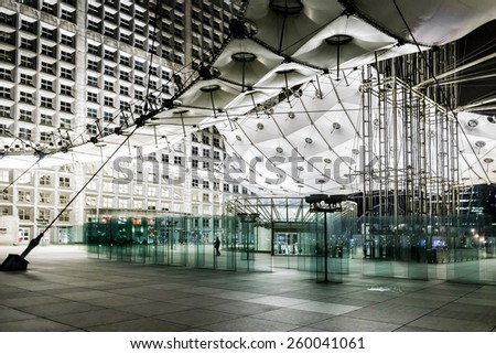 "PARIS, FRANCE - MAY 13, 2014: Grand Arch (""Grande Arche de la Defense"", 1989) at night - a monument in business district of Defense. Arch is a monument to humanity and humanitarian ideals."
