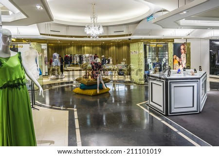 PARIS, FRANCE - MAY 10, 2014: Interior of Printemps (1865) in Paris - largest beauty Department Store in world with 45000 square meters of shopping. Printemps registered as Historic Monument. - stock photo