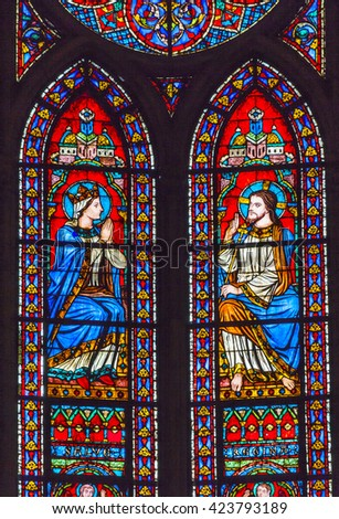 PARIS, FRANCE - MAY 31, 2016 Jesus Christ Mary Stained Glass Notre Dame Cathedral Paris France.  Notre Dame was built between 1163 and 1250 AD.   - stock photo