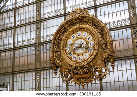 Paris, France - May 14, 2015: Large Golden clock in Museum d'Orsay.The museum houses the largest collection of impressionist and post-impressionist masterpieces in the world. - stock photo