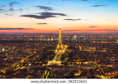 Paris, France - May 14, 2014: Light up at Eiffel tower with the Paris city skyline at night