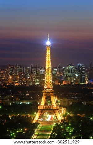 PARIS, FRANCE - MAY 31: Lighting of the Eiffel tower at dusk on May 31, 2011 in Paris, France. The Eiffel tower is the most visited monument  and world-class cultural of France - stock photo