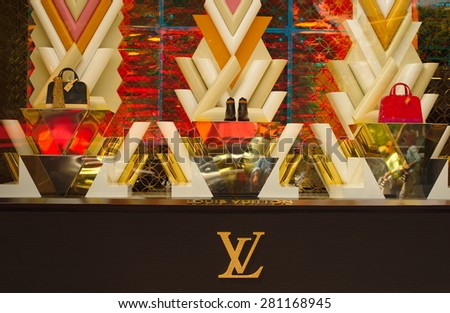 PARIS, FRANCE - May 24 : Louis Vuitton window display shop in Champ Elysee Avenue on May 24, 2015 in Paris, France.  - stock photo