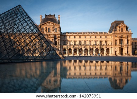 PARIS, FRANCE - MAY 29: Louvre Museum building and Pyramid early morning on May 29, 2013 in Paris, France. With 8.8 million annual visitors, Louvre is the most visited museum worldwide.