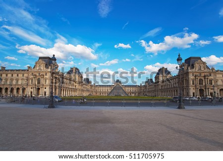 Paris, France - May 3, 2012: Louvre Pyramid and Louvre Palace in Paris in France. People on the background
