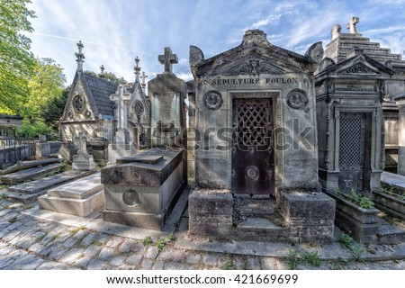 PARIS, FRANCE - MAY 2, 2016: Monumental  Pere-Lachaise cemetery, Paris. Each year thousands fans and curious visitors come to pay homage to celebrities grave