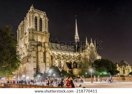 PARIS, FRANCE - MAY 17, 2014: Night view of Cathedral Notre Dame de Paris - a most famous Gothic, Roman Catholic cathedral (1163 - 1345) on the eastern half of the Cite Island. - stock photo