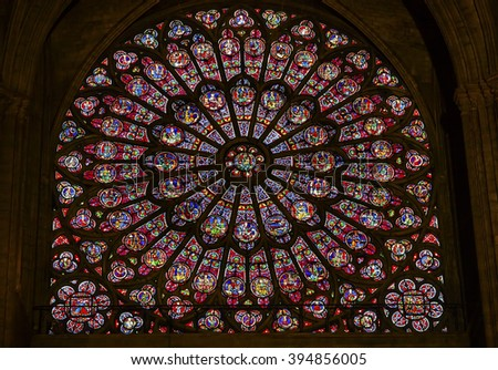PARIS, FRANCE - MAY 31, 2015 North Rose Window Virgin Mary Jesus Disciples Stained Glass Notre Dame Cathedral  Paris France.  Notre Dame built between 1163 and 1250 AD, window oldest from 1250. - stock photo
