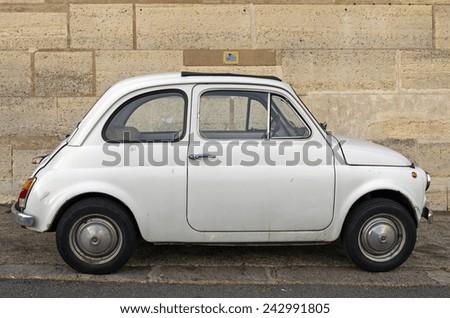 PARIS, FRANCE - MAY 28, 2012. Old white Fiat 500 on Paris street. - stock photo