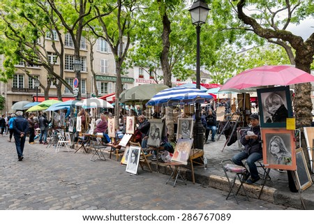 PARIS, FRANCE - May 28: Place du Tertre in Montmartre with street artists ready to paint tourists on May 28, 2015 in Paris, France - stock photo