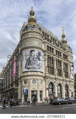 PARIS, FRANCE - MAY 10, 2014: Printemps (founded in 1865) in Paris - largest beauty Department Store in world with 45000 square meters of shopping. Printemps facade (registered as Historic Monument). - stock photo