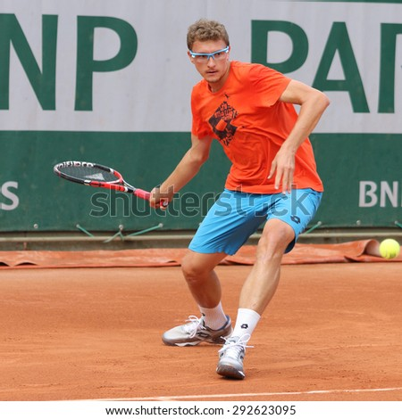 PARIS, FRANCE- MAY 23, 2015: Professional tennis player Denis Istomin of Uzbekistan practices for Roland Garros 2015 in Paris, France - stock photo