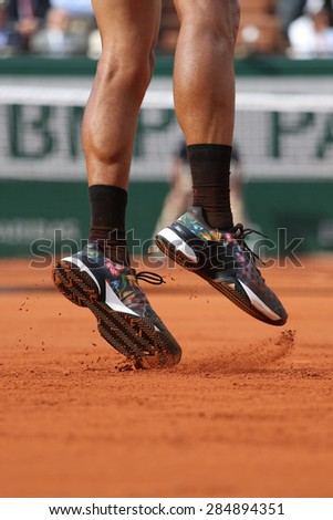 PARIS, FRANCE- MAY 24, 2015: Professional tennis player Jo-Wilfried Tsonga wears Adidas Y-3 Roland Garros Adizero all-court shoes during first round match at Roland Garros 2015 in Paris, France - stock photo