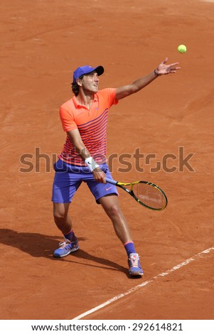 PARIS, FRANCE- MAY 25, 2015: Professional tennis player Lucas Pouille of France in action during his first round match at Roland Garros 2015 in Paris, France