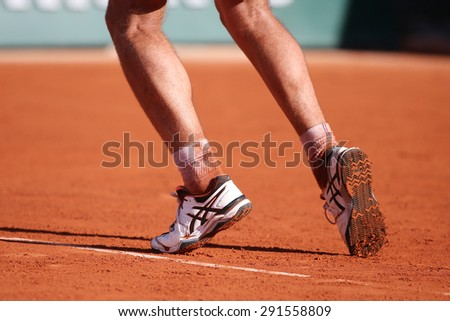 PARIS, FRANCE- MAY 30, 2015: Professional tennis player Richard Gasquet of France wears custom Asics Gel Resolution shoes during his third round match at Roland Garros 2015 in Paris, France - stock photo