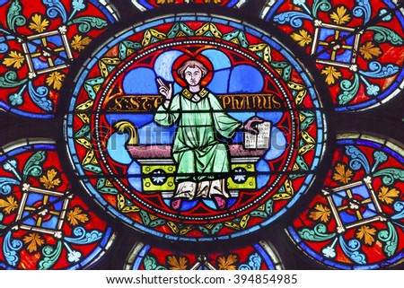 PARIS, FRANCE - MAY 31, 2015  Saint Stephen Stained Glass Notre Dame Cathedral Paris France.  Notre Dame was built between 1163 and 1250AD. - stock photo