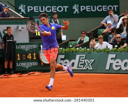 PARIS, FRANCE- MAY 24, 2015: Seventeen times Grand Slam champion Roger Federer during first round match at Roland Garros 2015 in Paris, France - stock photo