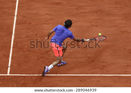 PARIS, FRANCE- MAY 29, 2015: Seventeen times Grand Slam champion Roger Federer during third round match at Roland Garros 2015 in Paris, France - stock photo