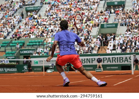 PARIS, FRANCE- MAY 27, 2015: Seventeen times Grand Slam champion Roger Federer in action during his second round match at Roland Garros 2015 in Paris, France - stock photo