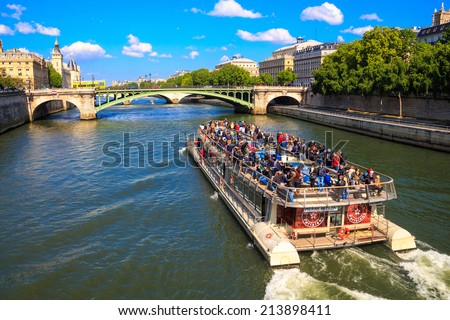 PARIS, FRANCE - May 3, 2014: ship Bateaux Parisiens on river Seine - stock photo