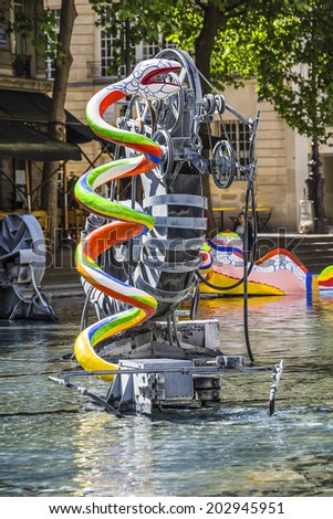 PARIS, FRANCE - MAY 13, 2014: Stravinsky Fountain (1983) is a fountain with 16 works of sculpture, moving and spraying water, representing works of composer Igor Stravinsky. Place Stravinsky, Paris.
