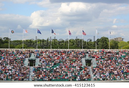PARIS, FRANCE- MAY 27, 2015: Tennis fans at the Court Philippe Chatrier at Le Stade Roland Garros during Roland Garros 2015 match in Paris, France - stock photo