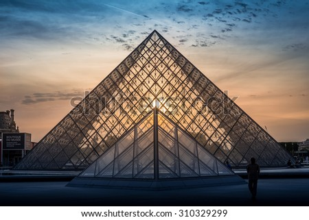 PARIS, FRANCE - May 11th, 2015: The Louvre Museum is one of the world's largest museums and the most popular tourist destinations in France - stock photo