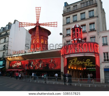 PARIS, FRANCE - MAY 28: The Moulin Rouge at the evening on May 28, 2011, France. Moulin Rouge is a famous cabaret built in 1889 and is located in the Paris red-light district of Pigalle. - stock photo