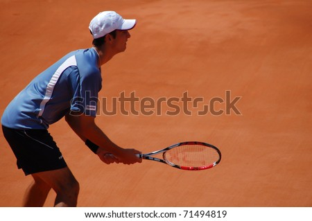PARIS, FRANCE - MAY 28: Thomaz Bellucci from Brazil waits for a service from Rafael Nadal during their first round match at the French Open in Roland Garros on May 28, 2008 in Paris. - stock photo