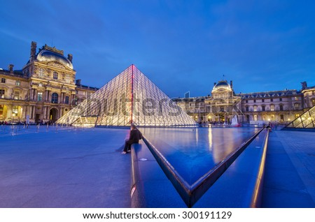 Paris, France - May 14, 2015: Tourist visit Louvre museum at twilight on May 14, 2015 in Paris. Louvre is one of the biggest Museum in the world, receiving more than 8 million visitors each year.  - stock photo